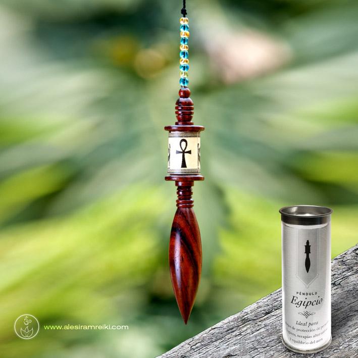 Péndulo egipcio de madera con envase